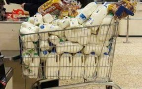COMMUNITY SHOP SELLS TESCO MILK FOR £4