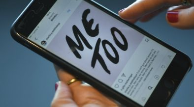 An image of a smartphone with a 'Me Too' message in the social media display