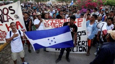 CLAIMING ASYLUM IN USA WAVING HONDURAN FLAGS?